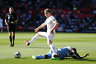 Stephen Kingsley of Swansea city is fouled by Mame Biram Diouf of Stoke city. Premier league match, Swansea city v Stoke City at the Liberty Stadium in Swansea, South Wales on Saturday 22nd April 2017.<br /> pic by Andrew Orchard, Andrew Orchard sports photography.