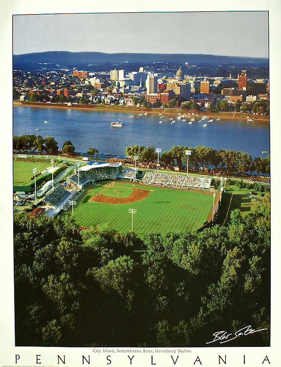 """Poster featuring an aerial view of the Senators stadium on City Island and the city of Harrisburg. White border with the word """"Pennsylvania"""" at the bottom with space for framing."""