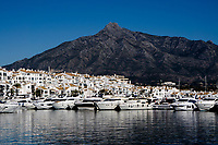 Puerto Banus marina and town with Coastal Mountain Range of Cordillera Penibética in the background. Puerto Banus is close to Marbella. Andalucia, Spain,<br />