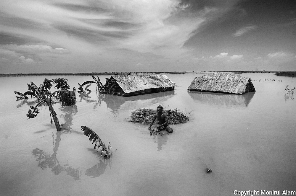 Sherajganj. Bangladesh. (2007). Majed lost his house during the event of flood at the bank of Jamuna. Bangladesh ranks first as the nation most vulnerable to the impacts of climate change. Scientists expect rising sea levels to submerge 17 percent of Bangladesh's land and displace 18 million people in the next 40 years.