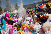 Revellers throwing around talcum powder. The annual Carnival in Zoque Coiteco, a district of Chiapas in Southern Mexico happens in the five days preceeding Ash Wednesday along with Carnival throughout the Americas. Participants dress in colourful costumes with masks depicting famous political and entertainment figures, and throw talcum powder at each other.