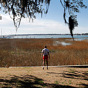 Sonny Richardson, 23, of Beaufort, is shown in mid-air while working out near the downtown marina off of Bay Street on February 19, 2014.