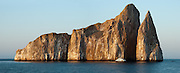 """Kicker Rock (Spanish name: """"Léon Dormido"""") represents the remains of a lava cone, now split in two off the northwest coast of Isla San Cristóbal (Chatham Island), which is the easternmost of the Galápagos archipelago, governed by Ecuador, in South America. In 1959, Ecuador declared 97% of the land area of the Galápagos Islands to be Galápagos National Park, which UNESCO registered as a World Heritage Site in 1978. Ecuador created the Galápagos Marine Reserve in 1998, which UNESCO appended in 2001. Panorama was stitched from 2 overlapping photos."""