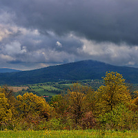 """""""Life of a Storm""""<br /> <br /> Heavy storm clouds mixed with sun create deep blue shadows on mountains beyond!!<br /> <br /> The Blue Ridge Mountains by Rachel Cohen"""