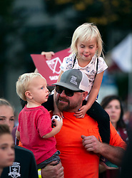Oct 21, 2019; Sacramento, CA, USA; A fan holds up his children during a celebration event for the new Sacramento Republic FC MLS soccer team at Capital Mall. Mandatory Credit: D. Ross Cameron-USA TODAY Sports