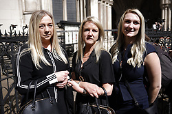 © Licensed to London News Pictures. 23/04/2021. London, UK. Former Post Office sub-postmaster Janet Skinner (C) is supported by neice Hayley Adams (L) daughter Toni Sisson outside The High Court. The Appeal Court has cleared the names of a group of 42 sub-postmasters - some of whom were jailed for stealing money after the Horizon accounting software was installed at Post Offices. At a previous High Court hearing a judge found the Fujitsu accounting system had major faults and defects. The Post Office has already agreed to pay £58m in a settlement with more than 500 sub-postmasters. <br />