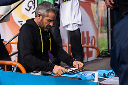 Manel Lacambra carefully placing the team branding on the Lotto Cycling Cup jerseys - Grand Prix de Dottignies 2016. A 117km road race starting and finishing in Dottignies, Belgium on April 4th 2016.