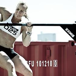 Angie Pye does a bar muscleup at Reebok CrossFit Ramsay's Grand Re-opening