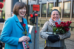 London, UK. 14th February, 2019. Frances O'Grady (l), General Secretary of the Trades Union Congress, and Katie Leslie (r) of the Public & Commercial Services (PCS) union show solidarity on a Valentine's Day-themed picket line outside the Department of Business, Energy and Industrial Strategy (BEIS) with outsourced support staff taking strike action to demand the London Living Wage and an end to outsourcing.
