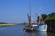 AT5BRE Sailing barge and boat moored quayside Snape maltings Suffolk England
