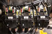 Engine parts inside an De Lijn electric tramcar in Ghent, Belgium.