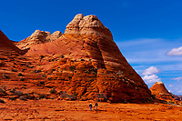 Hiking in the sandstone rock formations of Coyote Buttes North, Paria Canyon-Vermillion Cliffs Wilderness Area, Utah-Arizona border, USA