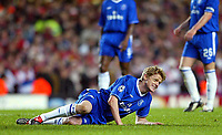 Photo: Scott Heavey.<br /> Chelsea v VFB Stuttgart. Champions League, 5th Round, Second Leg. 09/03/2004.<br /> Damien Duff feels the pain during his first return in months