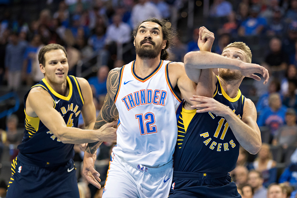 OKLAHOMA CITY, OK - OCTOBER 25:  Steven Adams #12 of the Oklahoma City Thunder goes for a rebound against Domantas Sabonis #11 of the Indiana Pacers at the Chesapeake Energy Arena on October 25, 2017 in Oklahoma City, Oklahoma.  NOTE TO USER: User expressly acknowledges and agrees that, by downloading and or using this photograph, User is consenting to the terms and conditions of the Getty Images License Agreement.  The Thunder defeated the Pacers 114-96.  (Photo by Wesley Hitt/Getty Images) *** Local Caption *** Steven Adams; Domantas Sabonis