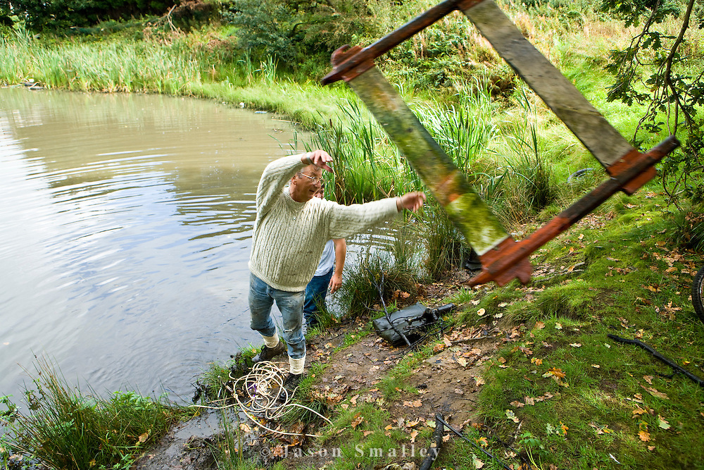 removing rubbish from a pond