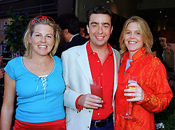 Left to right, MR & MRS NICK POWELL, he is the son of Sir Charles Powell and her sister MISS SUZANNA MURRAY god daughter of David Tang, at a party in London on 14th July 1999.MUF 38