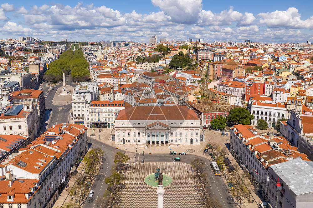 Aerial view of Rossio square and D. Maria II National Theater, empty streets during covid-19, in Lisbon downtown, Portugal