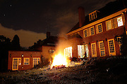 The 22-room mansion in Ingram Avenue is pictured at night when lit by a large fire set up by Lukatz, 23, from Poland, in order to get rid of garbage and old or broken furniture, on Tuesday, Sep. 25, 2007, in Hampstead, London, England. The 22-room mansion was last sold for UK£ 3.9M in 2002 and is now awaiting planning permissions to be demolished. Two new houses will soon be taking its place. Million Dollar Squatters is a documentary project in the lives of a peculiar group of squatters residing in three multi-million mansions in one of the classiest residential neighbourhoods of London, Hampstead Garden. The squatters' enthusiasm, their constant efforts to look after what has become their home, their ingenuity and adventurous spirit have all inspired me throughout the days and nights spent at their side. Between the fantasy world of exclusive Britain and the reality of squatting in London, I have been a witness to their unique story. While more than 100.000 properties in London still lay empty to this day, squatting provides a valid, and lawful alternative to paying Europe's most expensive rent prices, as well as offering the challenge of an adventurous lifestyle in the capital.
