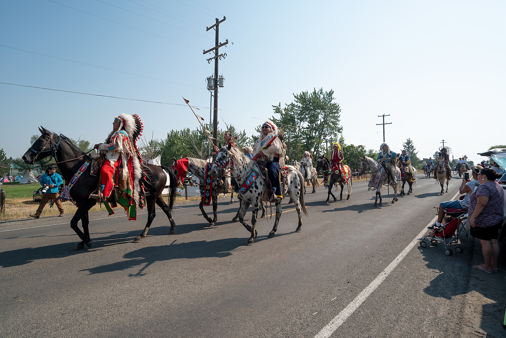 Nez Perce riders in a procession returning to Am'saaxpa in Oregon's Wallowa Valley.