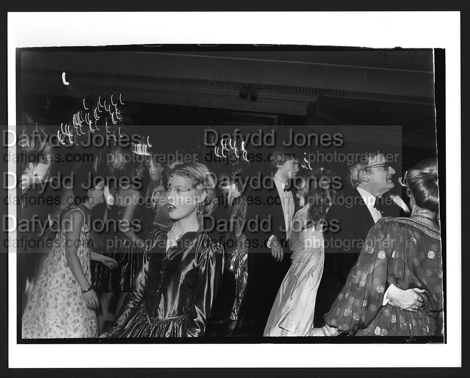 Lady Henrietta Bathurst.Cinderella Ball. Dorchester Hotel. December 1980. The Cinderella Ball was a charity Ball that raised money for the NSPCC. In the  era of punk, the New Romantics and Gaz Mayall's club Billy's in Soho this  was a straight-looking crowd. I wasn't working for anyone.  Wearing a  secondhand dinner jacket  I somehow persuaded the organisers to allow me in.  She does look v. beautiful.  Unlike nowadays I don't remember seeing any other photographers there. I didn't stay long as I had to rush back to catch the last train back to Oxford.