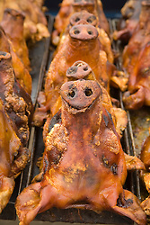 South America, Ecuador, Saquisili, roast pigs for sale, weekly food and crafts market draws indigenous people and tourists from surrounding villages