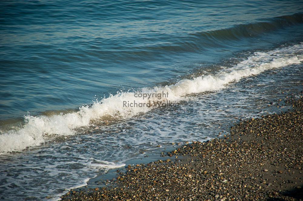 2017 NOVEMBER 06 - Waves, sand and rocks along Alki Beach, Seattle, WA, USA. By Richard Walker