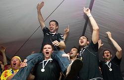 Uros Rapotec of Cimos Koper, Robert Konecnik of Cimos Koper, Matjaz Brumen of Cimos Koper, Bojan Skoko of Cimos Koper, Dusan Podpecan of Cimos Koper and fans celebrate  after the handball match between RK Cimos Koper (SLO) and SL Benfica (POR) in return final match of EHF Challenge Cup, on May 22, 2011 in Tent at Arena Bonifika, Koper, Slovenia. Koper defeated Benfica 31-27 and became Euro Challenge Champion 2011. (Photo By Vid Ponikvar / Sportida.com)