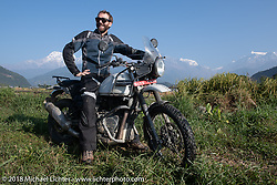 Sean Lichter  poses with a spectacular background of 23,000' peaks on day-4 our our Himalayan Heroes adventure riding from Pokhara to Kalopani, Nepal. Friday, November 9, 2018. Photography ©2018 Michael Lichter.