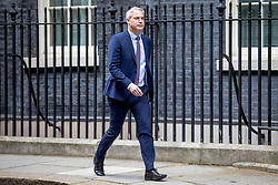"""© Licensed to London News Pictures. 13/03/2019. London, UK. Secretary of State for Exiting the European Union Stephen Barclay leaves 10 Downing Street after a meeting of the Cabinet. MPs will vote on whether to remove the option of a """"no deal"""" departure from the EU today, after Prine Minister Theresa May's proposed deal was defeated for a second time last night. Photo credit: Rob Pinney/LNP"""