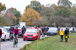 © Licensed to London News Pictures. 08/11/2020. London, UK. Members of the public go out to exercise in a busy Richmond Park in South West London on the 4th day of the new lockdown. Cyclists, walkers, and families descended on the park as traffic jams built up at car parks while Police patrolled the park in 4x4 vehicles. Prime Minister Boris Johnson announced new Covid-19 lockdown restrictions for England from last Thursday with pubs, restaurants, non-essential shops and gyms to close as the coronavirus infection rate continues to rise. Photo credit: Alex Lentati/LNP