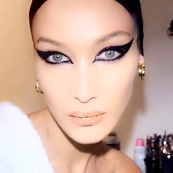 """Bella Hadid releases a photo on Instagram with the following caption: """"\ud83d\udc41\ud83d\udca5\ud83d\udc7d @PATMCGRATHREAL \ud83d\udc7d\ud83d\udca5\ud83d\udc41\n\u2764\ufe0f"""". Photo Credit: Instagram *** No USA Distribution *** For Editorial Use Only *** Not to be Published in Books or Photo Books ***  Please note: Fees charged by the agency are for the agency's services only, and do not, nor are they intended to, convey to the user any ownership of Copyright or License in the material. The agency does not claim any ownership including but not limited to Copyright or License in the attached material. By publishing this material you expressly agree to indemnify and to hold the agency and its directors, shareholders and employees harmless from any loss, claims, damages, demands, expenses (including legal fees), or any causes of action or allegation against the agency arising out of or connected in any way with publication of the material."""