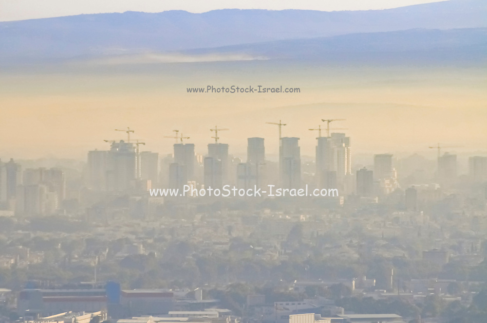 Haifa Bay covered in smoke and smog. The Inversion layer is visible. Haifa's industrial area is one of the largest sources of air pollution in the country. Photographed in Haifa Bay, Israel
