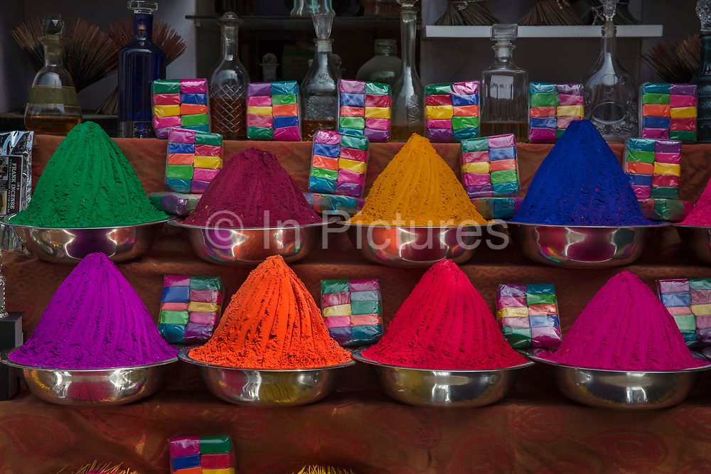 Brightly coloured paint for sale awaiting the Holi festival on 28th February 2018 in Kochi, Kerala, India. Holi is a Hindu festival that celebrates spring, love, and new life. Its a colourful festival, with dancing, singing and throwing of powder paint and coloured water. Holi is also known as the festival of colours.