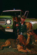 James Phelps is lead by his bloodhound Mac.  Phelps uses his dog to track prison escapees in Georgia.