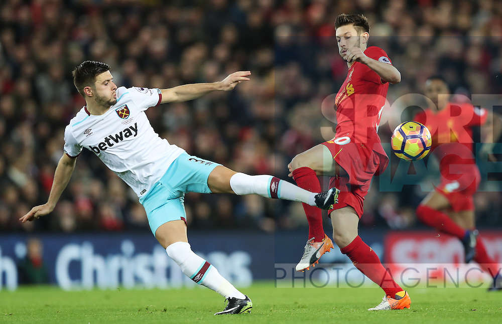 Aaron Cresswell of West Ham United and Adam Lallana of Liverpool during the Premier League match at Anfield Stadium, Liverpool. Picture date: December 11th, 2016.Photo credit should read: Lynne Cameron/Sportimage