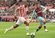 Glen Johnson of Stoke battles with Aaron Cresswell of West Ham (r). Premier league match, Stoke City v West Ham Utd at the Bet365 Stadium in Stoke on Trent, Staffs on Saturday 29th April 2017.<br /> pic by Bradley Collyer, Andrew Orchard sports photography.