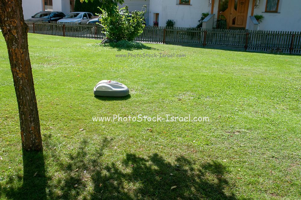 battery powered robotic lawn mower cutting grass