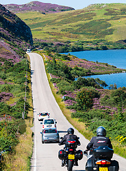 Tourist traffic on road in the north of Scotland part of North Coast 500 tourist road trip route.