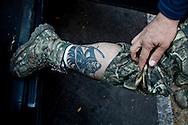 Il tatuaggio portafortuna di un membro dell'autodifesa.