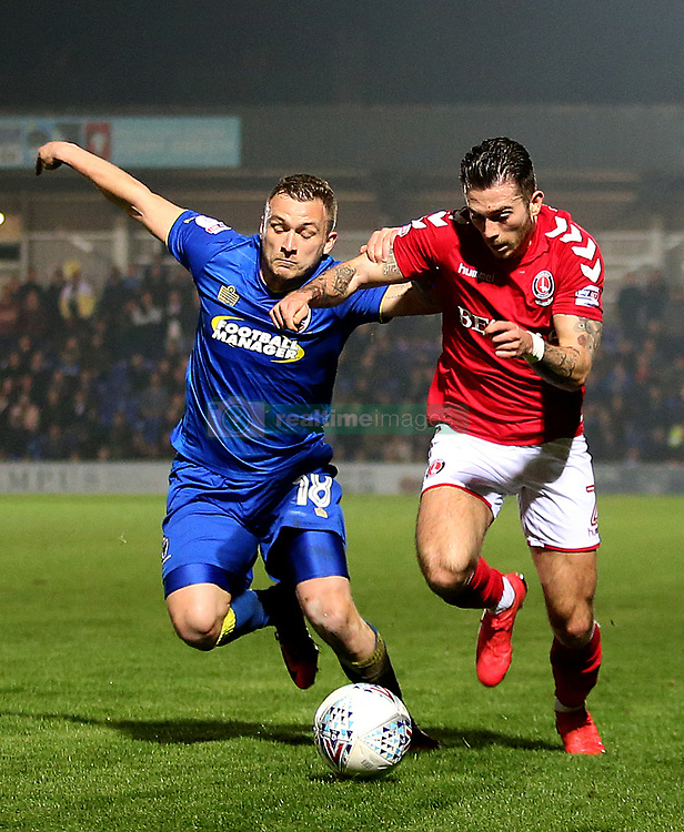 Charlton Athletic's Lewis Page and AFC Wimbledon's Dean Parrett in action