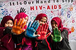 Dec. 1, 2016 - Medan, Indonesia - Indonesian Muslim women participate during commemoration of World AIDS Day in Medan, Indonesia.  (Credit Image: © Xinhua via ZUMA Wire)