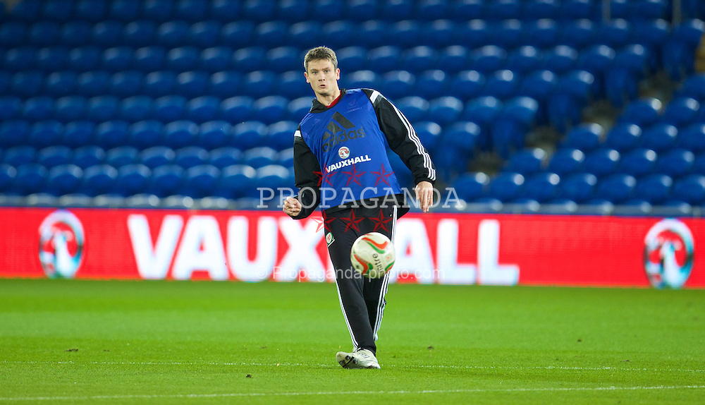 CARDIFF, WALES - Friday, November 15, 2013: Wales' Owain Tudur Jones during a training session at at the Cardiff City Stadium ahead of the International Friendly match against Finland. (Pic by David Rawcliffe/Propaganda)