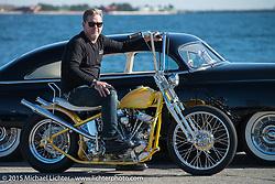 "Big Scott Stopnik with his 1949 HD Panhead ""CYCLE RAY"" in front of Tom Foster's 1952 Chevrolet Styleline Deluxe ""CRACKER BOX"" before the Mooneyes Yokohama Hot Rod & Custom Show. Yokohama, Japan. December 5, 2015.  Photography ©2015 Michael Lichter."