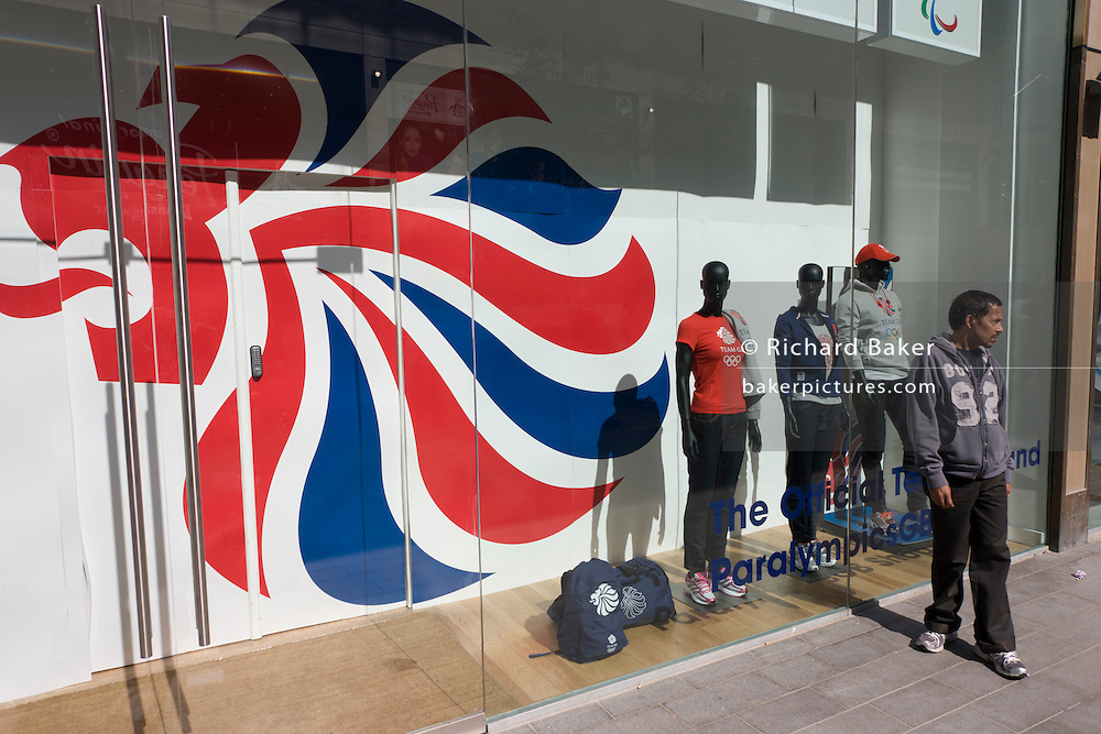 The Official 2012 Olympic merchandise outlet on the opening day of the Westfield Stratford shopping mall. Situated on the fringe of the 2012 Olympic park, Westfield hosted its first day to thousands of shoppers eager to see Europe's largest urban shopping centre. The £1.45bn complex houses more than 300 shops, 70 restaurants, a 14-screen cinema, three hotels, a bowling alley and the UK's largest casino. It will provide the main access to the Olympic park for the 2012 Games and a central 'street' will give 75% of Olympic visitors access to the main stadium so retail space and so far 95% of the centre has been let. It is claimed that up to 8,500 permanent jobs will be created by the retail sector.