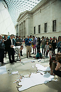 "Bp-or-not-Bp stage a splash mob dressed as merfolk at the British Museum in protest against the continued sponsorship by the oil company Bp, in particular against  the sponsorhsip of the exhibition 'Sunken Cities"". The merfolk sang and performed around the museum with placards rejoycing BP and the rising sea levels because as merfolk they will benefit from climate change. The public were invited to add their thoughts on future sunken cities around the world and to participate in the ongoing debate on oil and climate change. (photo by Kristian Buus/In Pictures via Getty Images)"