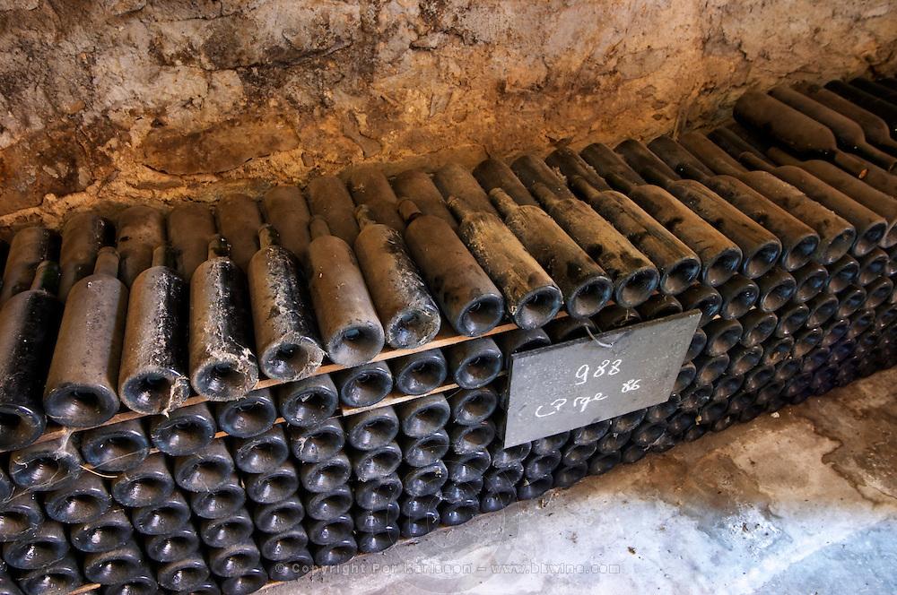 Piles of old bottles aging in the cellar, rouge red 1986 Chateau Vannieres (Vannières) La Cadiere (Cadière) d'Azur Bandol Var Cote d'Azur France