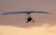 Hang glider pilot Thomas Atkins and a passenger fly above Randall Airport in Middletown on Friday, Aug. 23, 2013. The hang glider rides are offered by Hangar 3. (AP Photo/Times Herald-Record/TOM BUSHEY)