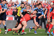 DTH Van Der Merwe © of the Scarlets is stopped in his tracks by Gareth Anscombe of the Cardiff Blues.  Guinness Pro12 rugby match, Scarlets  v Cardiff Blues at the Parc y Scarlets in Llanelli, West Wales on Saturday 2nd April 2016.<br /> pic by  Andrew Orchard, Andrew Orchard sports photography.
