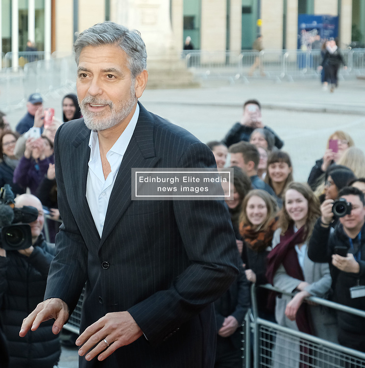 George Clooney and his wife Amal, representing the Clooney Foundation for Justice, arrive to collect an award for their charity work at the People's Postcode Lottery Charity Gala in Edinburgh <br /> <br /> Pictured: George Clooney and wife Amal Clooney<br /> <br /> (c) Aimee Todd | Edinburgh Elite media