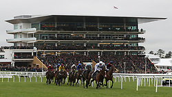 The field takes the bend in the Crest Nicholson Handicap Chase